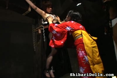 Bondage crucifixion0. A Japanese bondage slut is suspended on the cross and subjected to kinky humiliations